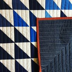 Blue ombre half square triangle quilt straight stitched