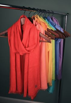 Drape, hang, or tie scarves around suit hangers for an easy, clean look. This will help show how they will hang around the neck.