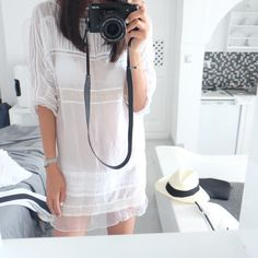 Eniko Tiered Tunic Dress-White $129.00 http://www.helloparry.com/collections/july-arrivals/products/eniko-tiered-tunic-dress-white