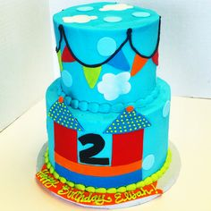 Two tiered bouncy house themed birthday cake by Les Amis Bake Shoppe / Baton Rouge, LA
