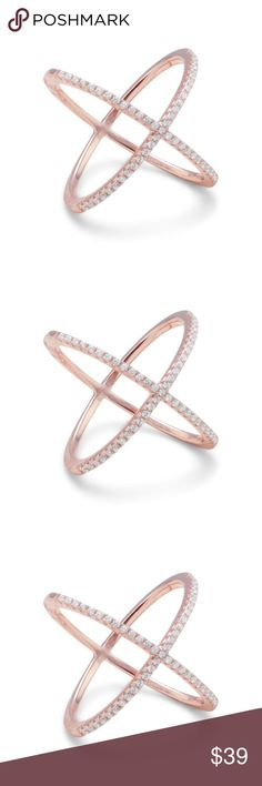 18 Karat Rose Gold Plated Criss Cross 'X' Ring 18 karat rose gold plated criss cross 'X' ring with Signity CZs. The ring measures approximately 20mm. The Signity CZs embellish the top of the ring, and the back is polished. Made with .925 Sterling Silver. Jewelry Rings