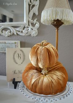 Bring simple touches of fall to your home's entryway by stacking some sweet velvet pumpkins on a cake stand.  An autumn wall sign from HomeGoods greets guests, and a lamp (with fringed shade, of course) warms up your decor.  Happy Almost Fall and Halloween!   {Sponsored by HomeGoods}