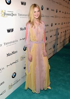 Elle Fanning in a sherbet-hued gown at the Women in Film Pre-Oscar party.