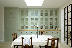 A whole wall of beautifully fitted bespoke cabinets from deVOL's Classic English Kitchen range