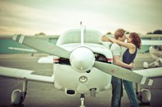 Aviation engagement. This is not us, but we got engaged in a cessna and have similar pics! Cute.
