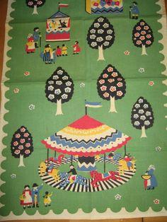 Charming Mid-Century Merry-Go-Round Tea Kitchen Towel Leacock Prints. $32.00, via Etsy.