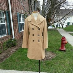 J Crew 100% Wool Coat Medium length. just has some really light yellow stains on lining not noticeable. The price is including the extra shipping cost. J. Crew Jackets & Coats