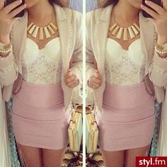 I like the white lace corset with the pink skirt and the cream blazer. Perfect balance of color.