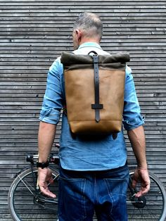 58d75d33b508a Leather backpack with waxed canvas roll to close top and vegetable tanned  shoulder straps