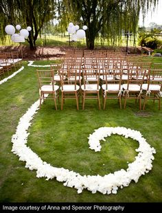 Don't think I'd ever do an outdoor wedding but I love the idea of flower petals for the aisle