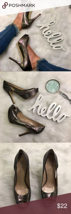Snake Print Silver Heels Love these stunning shoes! Featuring a platform and cutouts, these will definitely spice up your outfit Marc Fisher Shoes Heels