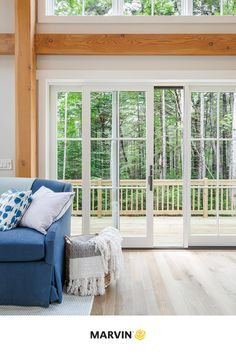 This cozy farmhouse design with cottage style elements blurs the line between indoors and out by incorporating large windows and sliding glass doors. White trim contrasts beautifully with exposed living room beams. American Farmhouse, Modern Farmhouse Style, Farmhouse Design, Cozy Cottage, Cottage Homes, Yankee Barn Homes, Farmhouse Architecture, Cottages And Bungalows, Cottage Style Decor