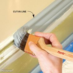 Cutting-in is a skill that takes practice to master, but it's worth the effort. To cut in, first load the brush. Then wipe most of the excess paint off by gently scraping the bristles on the edge of the can. Start by pulling the brush along the edge, but keep the bristles about 1/4 in. away from the wall or ceiling to deposit some paint on the wood. Now return with another brushstroke, this time a little closer. Sneaking up to the line like this is easier than trying to get it perfect on the…