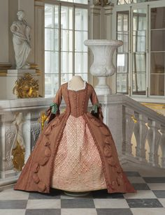 "Title: Casement Dress ""robe à la française"" of Silk Fabric Red-Brick Color Place of creation: Western Europe (?), Russia (?) Date: 1760s Material: silk, linen Inventory Number: ЭРТ-16017"