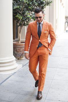 Orang suit, ballsy  confident  Men's fashion.