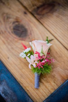pink boutonniere http://www.weddingchicks.com/2013/09/05/geometric-wedding/