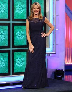LAUNDRY: Navy gown w/lace upper bodice, high scoop neckline, sleeveless, midriff through hipline in horizontal stitch pleated jersey, skirt in lace w/vertically stitch pleated insets on sides, flared | Vanna White's dresses | Wheel of Fortune