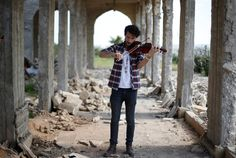 Ameen Mukdad, a violinist from Mosul who lived under ISIS rule for two and a half years, while they destroyed his musical instruments, performs at Nabi Yunus shrine in eastern Mosul, Iraq, on April 19, 2017.