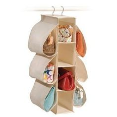 """Natural Canvas Hanging Purse Organizer (Natural Canvas) (30""""H x 6""""W x 14""""D). Scroll down and there is a canvas three shelf hanging organizer that would work as well for larger purses."""