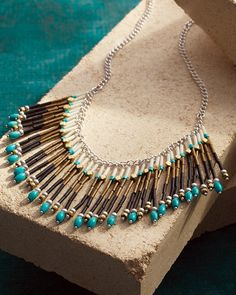 Head west with this colorful fringe Necklace from the Sterling Silver Collection. Its swingy fringe pieces feature hues of brown, black, gold and turquoise that are guaranteed to make a stylish statement. Rock it with a fringe duster cardigan and your favorite booties to gallop into free-spirited style.