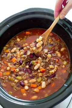 Slow Cooker Pasta e Fagioli Soup. Super hearty, meaty, thick Italian soup loaded with veggies, meat and beans. ♥ The Recipe Critic