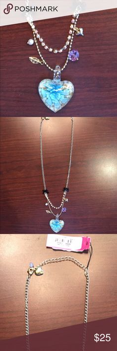 NWT Betsey Johnson Necklace 3D Heart Flower Inside NWT Betsey Johnson Double Chain Necklace 3D Heart With Flower Inside •Chain that has the 3D heart pendant also has dangling items on both sides (bead, pearl, leaf, heart).  •Two black bows (one on each side) begins the double chain look.  •The other chain is s short strand of square rhinestones.  •Retired. Rare. Hard to find!   Retail price: $38.00 Betsey Johnson Jewelry Necklaces