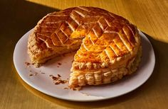 The galette des rois, celebrating Epiphany, the day the Three Kings (les rois) visited the infant Jesus, is baked throughout January in France. Composed of two circles of puff pastry sandwiching a frangipani filling, each comes with a crown and always has Dorie Greenspan, Puff Pastry Recipes, Almond Cream, What To Cook, Sweet Tooth, Bakery, Sweet Treats, Dessert Recipes, Cooking