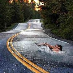 Either that's a deep puddle or it's fantastic 3D street art... either one is cool...lol......VERY COOL