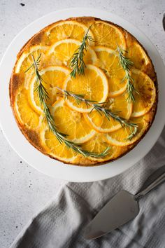 Orange and Rosemary marry in this light, orange upside down cake. Moist, delicate and not too sweet, a slice of this cake is perfect for your afternoon tea or coffee!