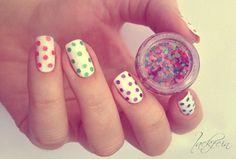 Using big glitter nail polish to make polka dots.