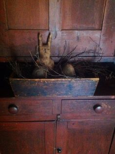 Prim Bunny nestled in a treenware bowl and displayed on an antique stepback cupboard <3