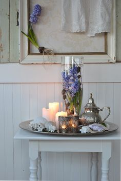 love the mercury glass votives paired with old silver and white seashells
