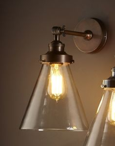 The simplicity of the industrial look allows you to mix it with a variety of decor and architectural styles. Our Francis Wall Lamp fuses the beauty of glass and antique brass with unpretentious design. Mix with other industrial pieces, French classics or coastal chic