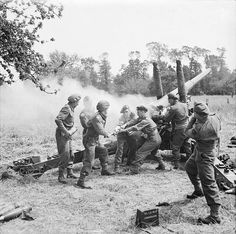 The Battle for Normandy: A British 4.5 inch gun being primed ready for firing by men of 211 Battery, 64th Medium Regiment, Royal Artillery near Tilly-sur-Seulles, during the holding operation before the push to Caen.