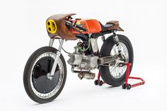 Woodface: This little Honda custom moped is ready to race