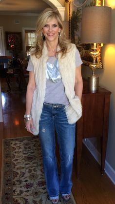 Heart Tshirt and silver belt  #JCrew @jcrew. #MissMe Jeans. Fur vest #NeimanMarcus. @neimanmarcus Silver Wedge Sandals #MichaelKors. @michaelkors