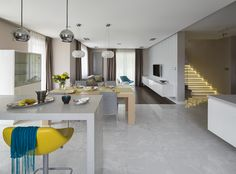 Colourful modern dining room, yellow hocker, big hocker, hoker, Caboche lamp, highlighted marble stairs