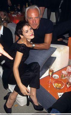 Winona and Giorgio Armani at an event