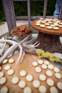 My groom's table... He wasn't a fan of cake, so we did mini lemon tarts, pecan pies, and sweet potato casserole treats. Decorated with tree stump and deer antlers