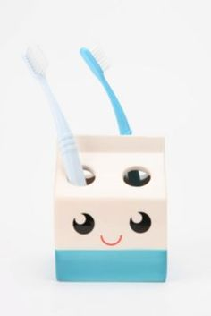 milk carton toothbrush holder.