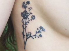 Botanical wildflower tattoo. …