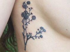 Botanical wildflower tattoo.