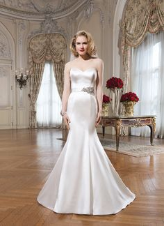 Justin Alexander wedding dresses style 8659 A strapless regal satin mermaid is adorned with a beaded motif on a bias  belt. Crystal and satin buttons cover the back zipper and this style  has a chapel length train (Belt available as style A027).