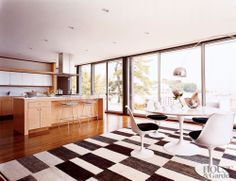 In a 1962 Connecticut home, the kitchen and breakfast area have an open plan. Saarinen Tulip chairs and table sit beneath an Arco floor lamp.