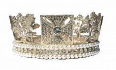 """The King George IV State Diadem forms part of the Crown Jewels. The Diadem was made in 1820 for the coronation of George VI. It was constructed to encircle the velvet """"Cap of Estate"""" that he wore in the procession to Westminster Abbey.    The diadem included 1333 diamonds weighing 327.75 carats and 169 pearls"""
