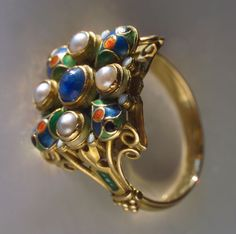 Henry George Murphy. Arts and Crafts ring. Celtic, Gothic, medieval and renaissance influences.  Gold, enamel, sapphire, pearls.  H: 1.5 cm (0.59 in) 1929. View 3.