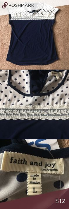 Faith and Joy Cute Top Size L. New with tags. Great condition. Has bow on back of top. Tops Blouses