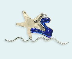 """""""Fluid Cosmos"""" 18k gold and art glass pin is a wonder in metal working. 18 karat gold, 14 karat white gold and 14 karat gold come together with bright blue art glass  in this beautiful, moving pin. A star is born!"""