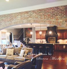 Living room Madden Homes - crown molding continued on brick arch