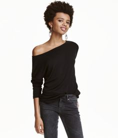 Black. Long-sleeved top in soft, viscose-blend jersey. Boat neck, dropped shoulders, and short slits at sides.